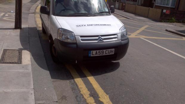 Not only was the traffic warden parking on double yellow lines...