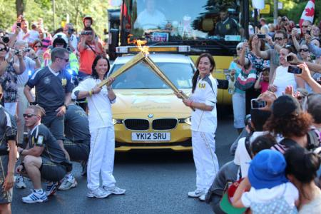 Thousands took to the streets to watch the Olympic torch pass through Merton.