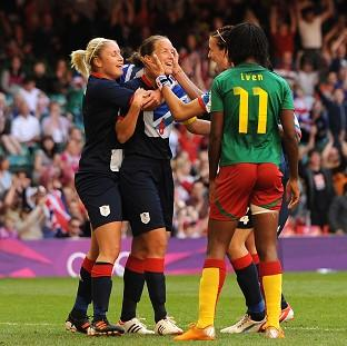 Casey Stoney, centre, scored the opener as GB beat Cameroon to clinch a last-eight berth