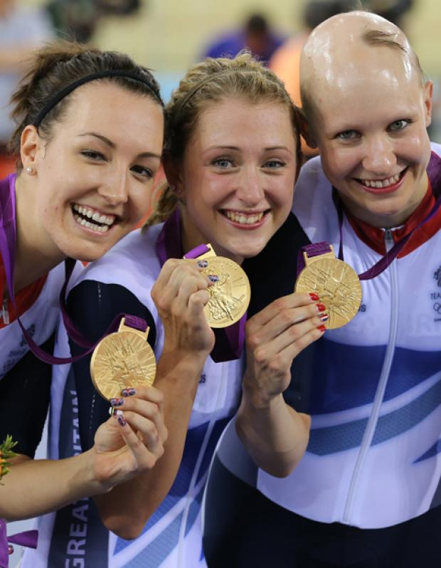 Laura Trott (centre) is first woman cyclist to win two Gold medals at a single Games for Team GB