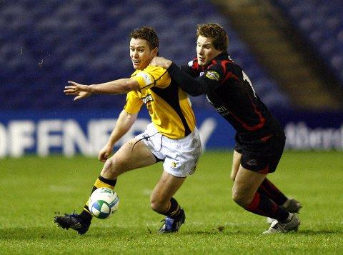 Flash back: Phil Godman, right, tackles Eion Reddan while on Heineken Cup duty with London Wasps Picture: onEdition