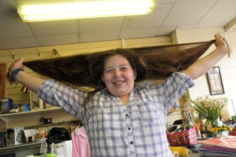 School girl Hannah Beckett cuts her long locks for charity
