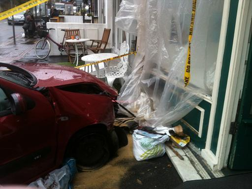 Elderly woman crashes car into shoe shop