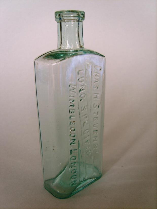 A bottle that once contained Stevens' tuberculosis remedy, Lung Specific. Made around 1915, it is part of the Museum of Wimbledon's artefacts collection