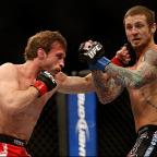 Your Local Guardian: Hitting out: Brad Pickett lands one on Eddie Wineland on Saturday   Picture: Josh Hedges