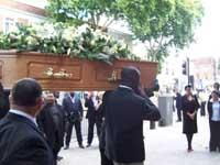 Final farewell: James Oyebola's coffin is carried in the church