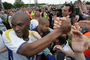 Man of the people: Veteran Marcus Gayle is equally at ease being congratulated by AFC Wimbledon fans Deadlinepix Hakan Yazici HY2492
