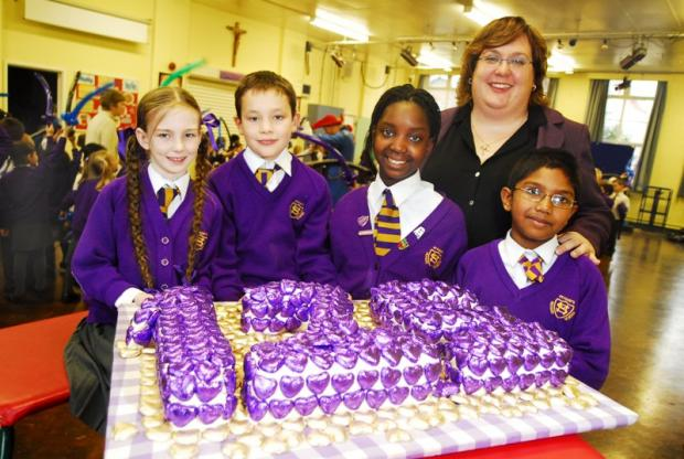 Headteacher Sarah Crouch celebrating the school's 125th anniversary with pupils in 2008.
