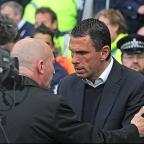 Thank you: Gus Poyet embraces Ian Holloway before the game last Monday