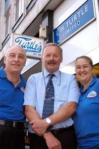 Turtle power: Jeremy Turtle (centre) with Trevor Keywood and Lucy Harding outside the store