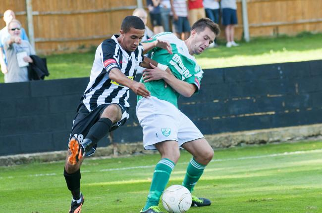 Goal-scorer: Leatherhead's Tom Parkinson does battle with Tooting's Troy Williams    SP73087