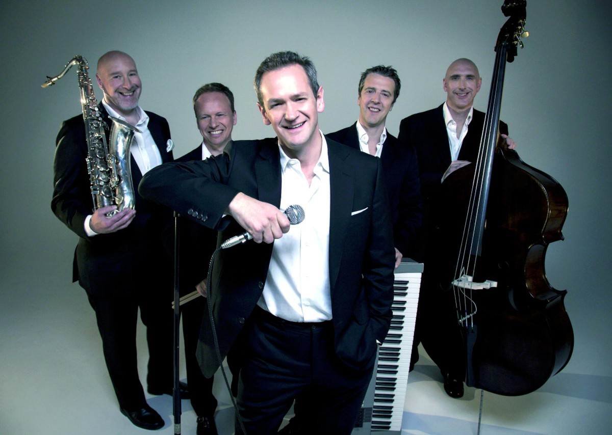 TV game show host Alexander Armstrong with his band