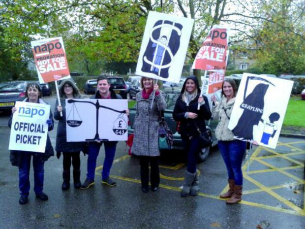 Probation staff strike near their office in Redhill
