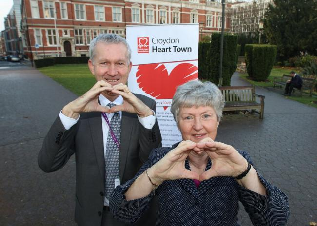 Councillor Margaret Mead and Dr Robinson with the Heart Town banner