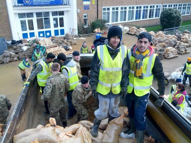 Your Local Guardian: Zafar Ahmad preparing sandbags to help flood stricken residents