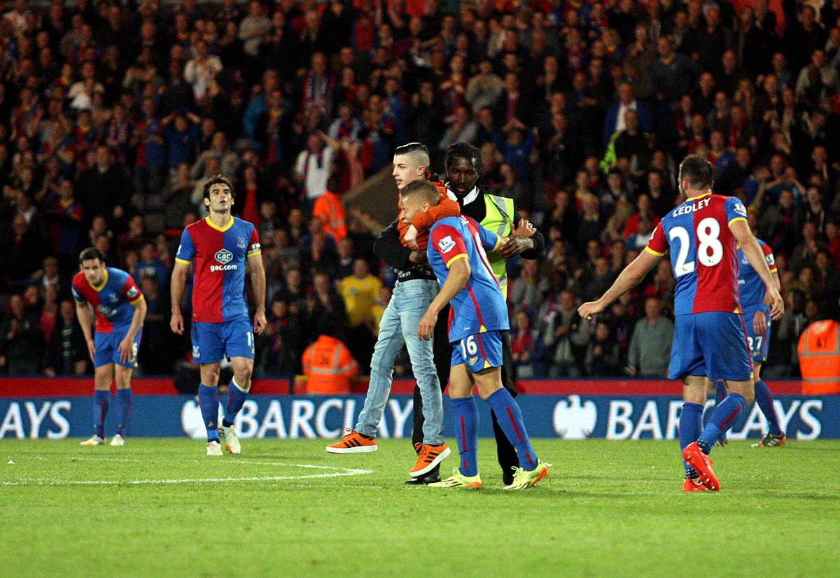 Your Local Guardian: Dwight Gayle is congratulated by a young uninvited Palace fan after making it 3-2