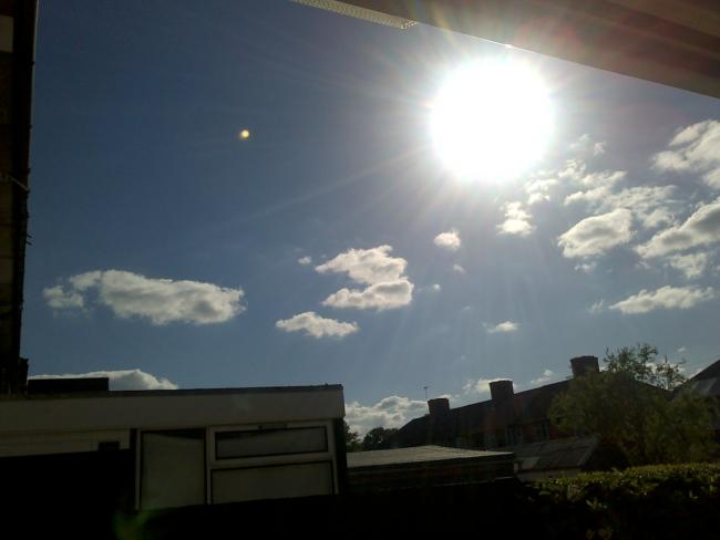 Is the blob to the left of the sun a UFO? (Pic: Kelly Stevenson)