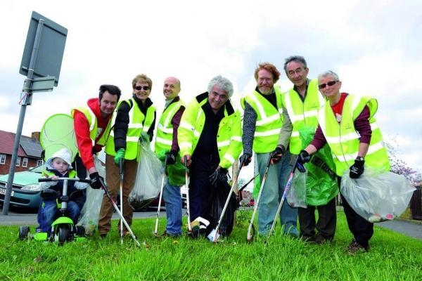 Cleaning up: councillors joined residents for a Spring clean up in April, but are they doing enough to stop littering?
