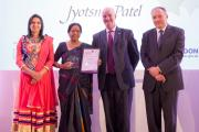 Jyotsna Patel proudly clutches her certificate and trophy at the awards ceremony