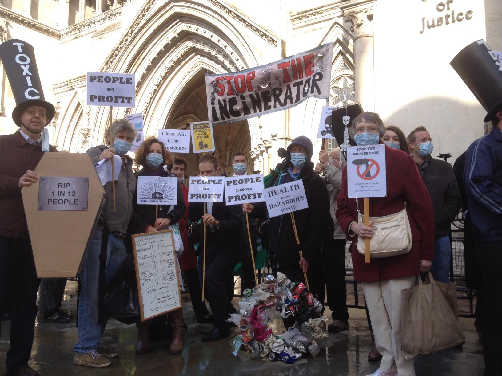 Anti-incinerator campaigners outside the Royal Courts of Justice