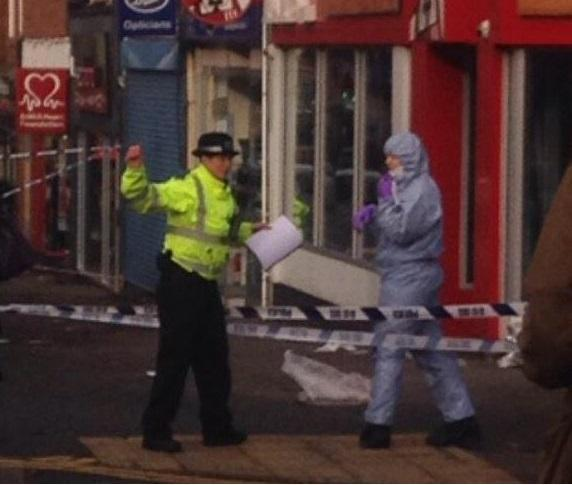 Officers at the scene of the Worcester Park double stabbing