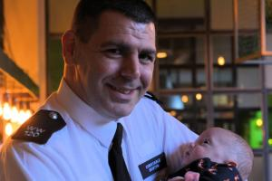 Hero police officer reunited with baby boy he saved by running him to hospital