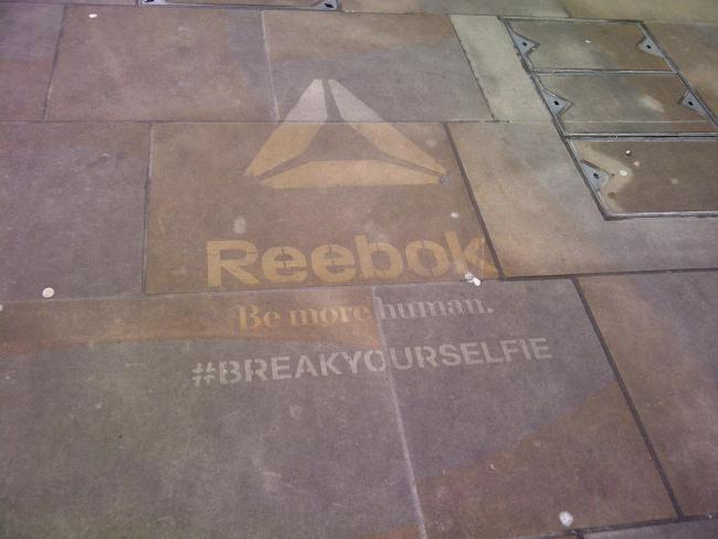 Not impressed: A Reebok logo sprayed on to a pavement in Richmond