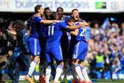 Chelsea players celebrate a first Premier League title since 2010