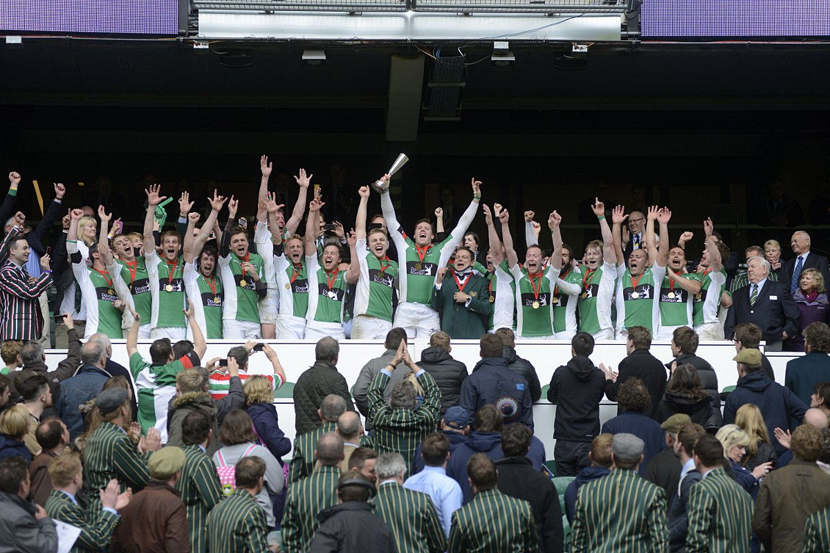Moment to cherish: Colin O'Keeffe raises the National Junior Vase at Twickenham stadium last season, and now the skipper is stepping down to make way for the next generation  					              SP91112