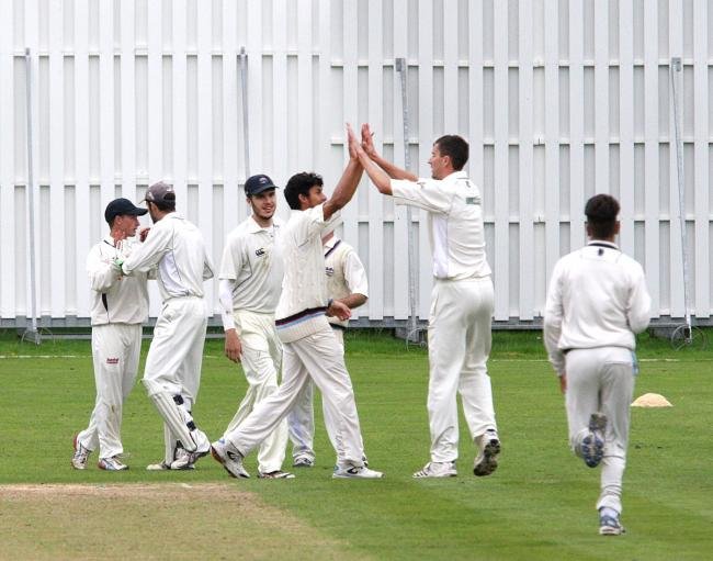Closing in: Beddington enjoy the dismissal of Leatherhead's Simon Roberts, caught by Kyle Moolman off the bowling of Ryan Cummins
