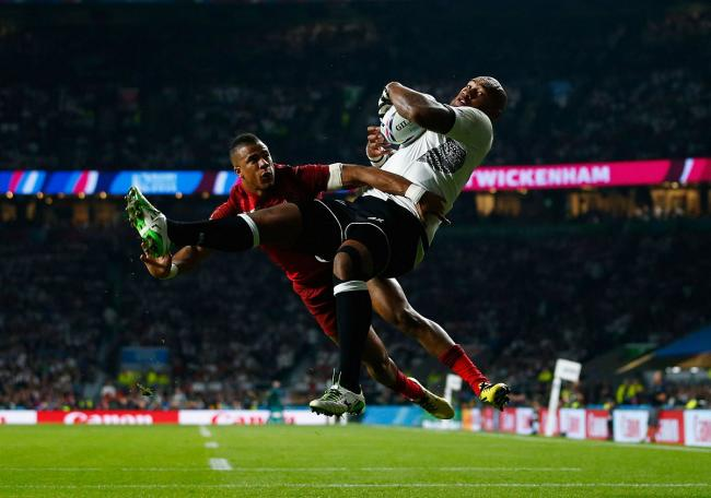 Big occasion: Fijian gian Nemani Nadolo catches a cross field kick ahead of England's Anthony Watson to score Fiji's try on World Cup opening night