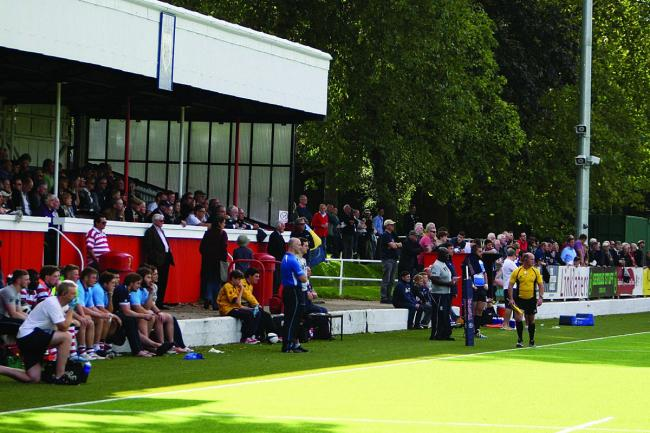 New look: Park fans watch the action of the 3G pitch         Pictures: David Whittam