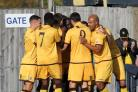 Happy days: Sutton United's Kevin Amankwaah is mobbed after making it 2-0              Pictures: Paul Loughlin