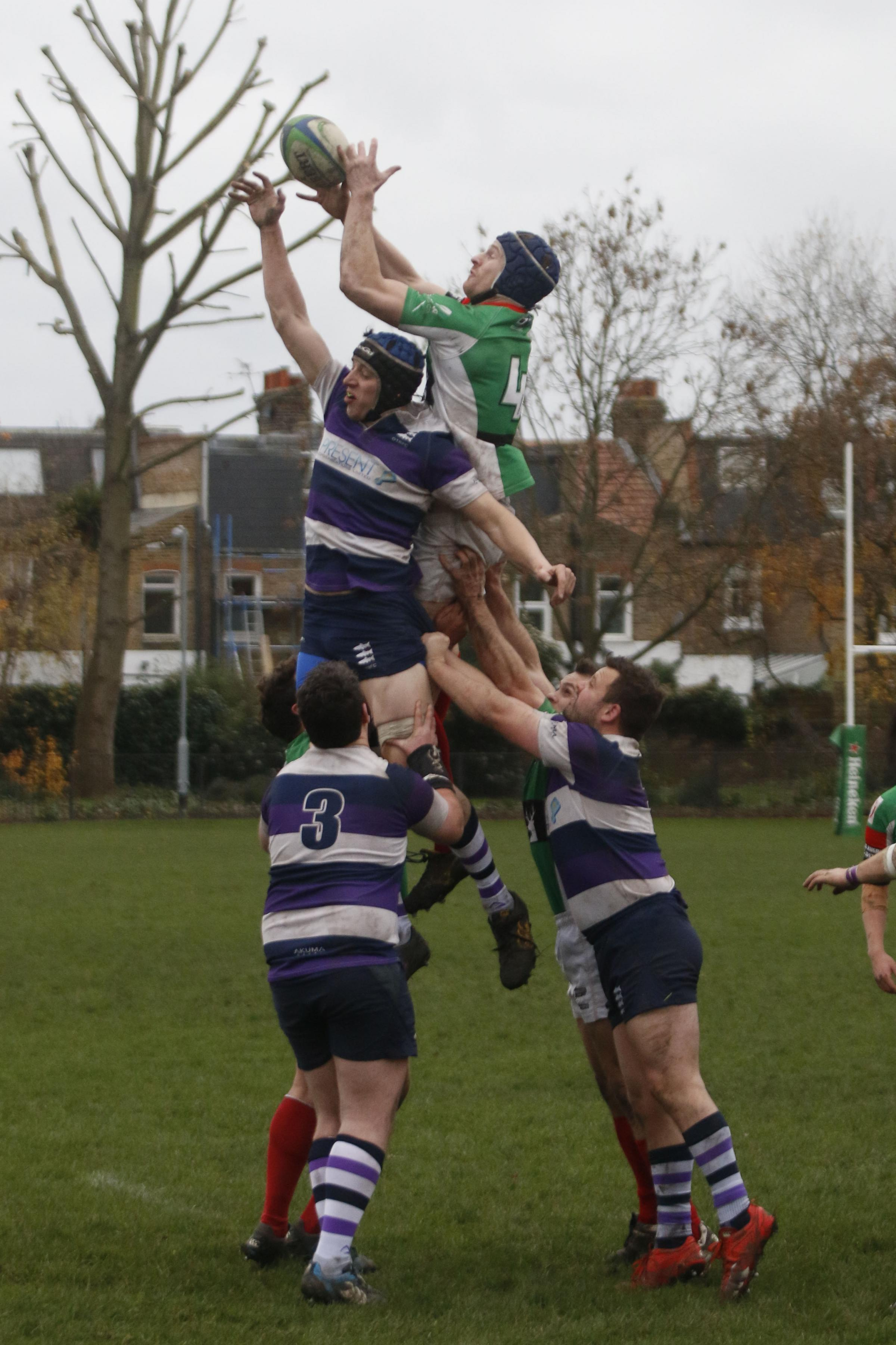 Reaching new heights: Duncan Madden gets up highest to claim a Battersea Ironsides line-out during the weekend win over Old Tiffinians  		              SP94644