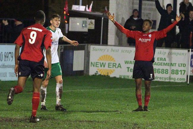 King pin: Hampton's Jamal Lowe, right, laps up the applause for his second goal against Bognor Regis Town on Tuesday night
