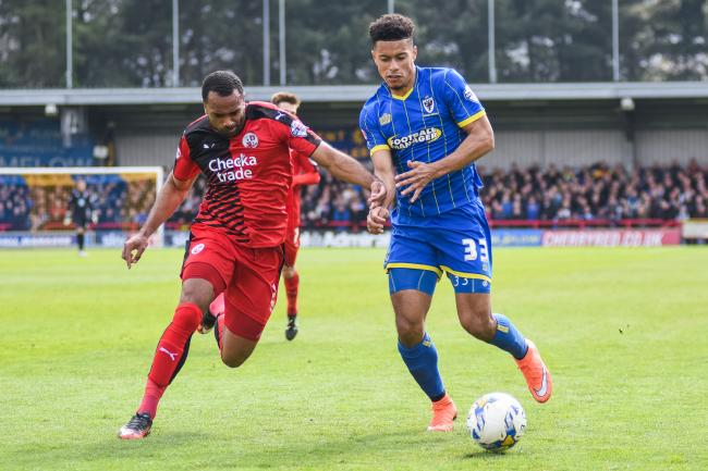 Off the mark: Lyle Taylor scored the Dons' consolation in a 3-1 opening day League One defeat at Walsall on Saturday