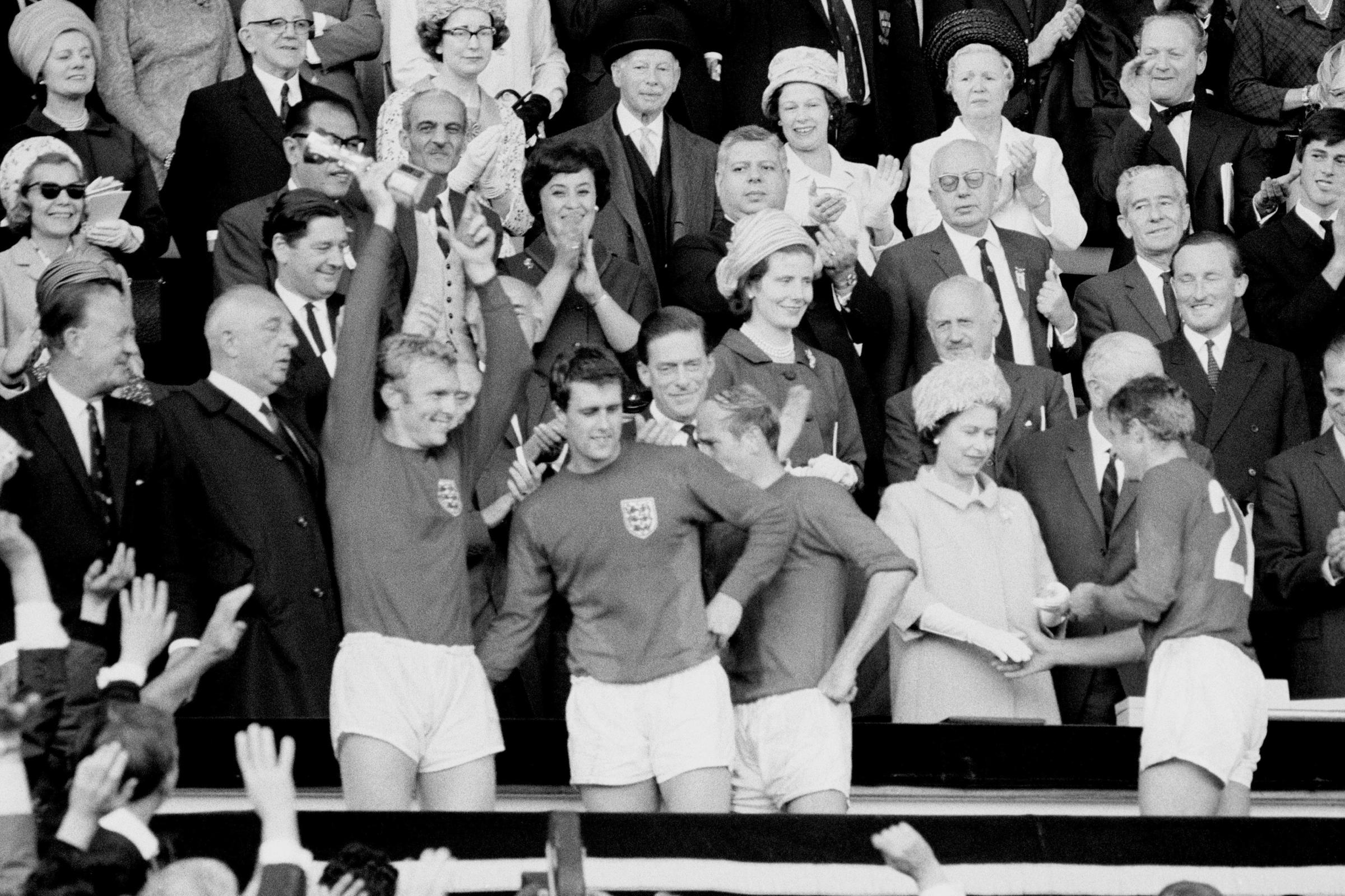 England Captain Bobby Moore holds aloft the Jules Rimet Trophy, followed by hat-trick hero Geoff Hurst, Bobby Charlton and Roger Hunt (PA Photo/Empics)