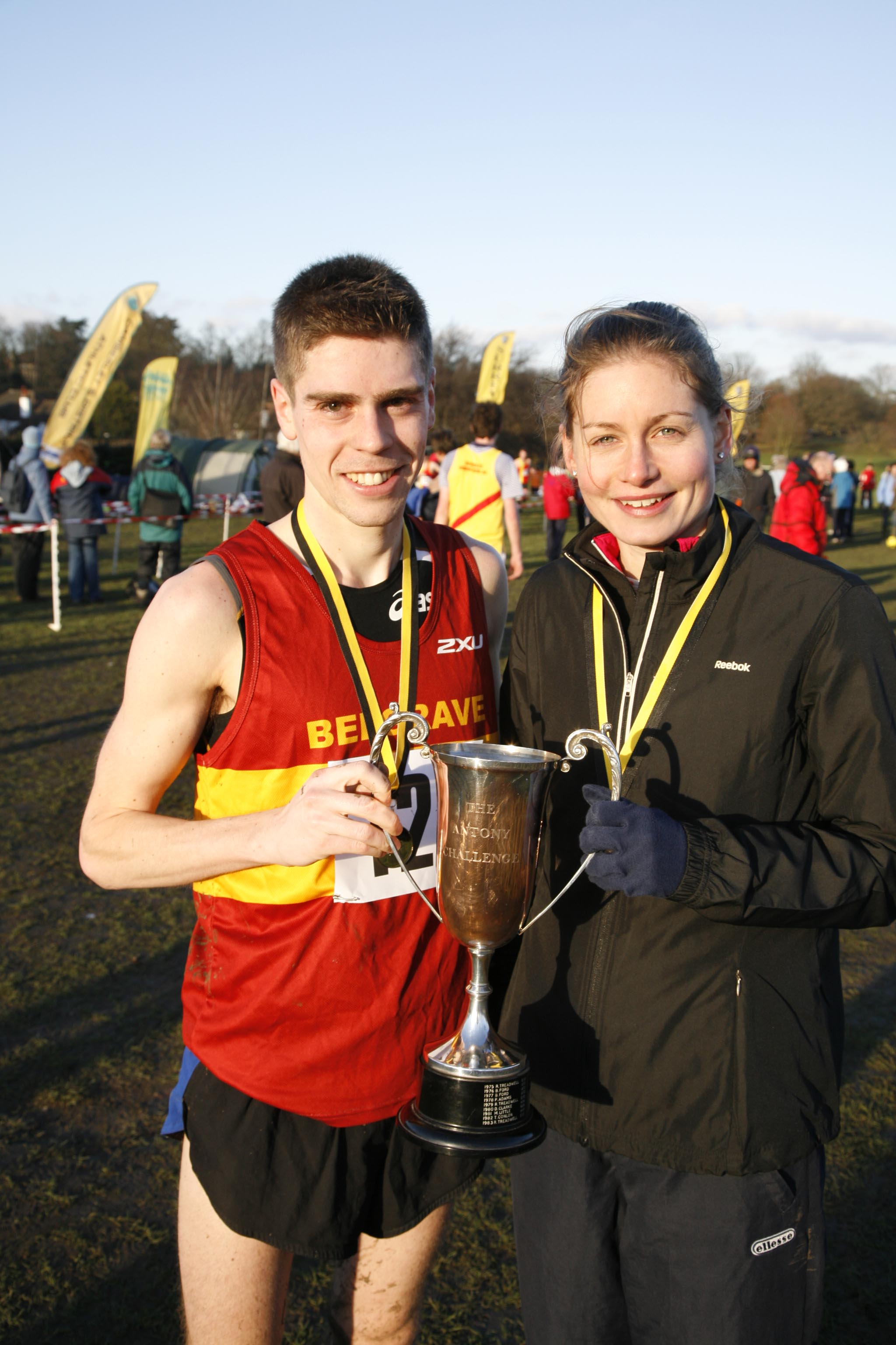 City slickers: Phil Wicks, left, and Emily Wicks winning Surrey Cross Country Championship gold earlier in their careers