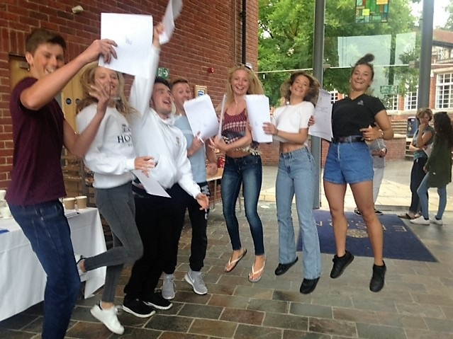 Jumping for Joy: Tom Jimena-Tilling, Antonia Turner, Elliot King, Oliver Darroch, Rosie Onslow-Wyld, Harriet Jennings and Portia Jennings celebrate their A level results at Epsom College