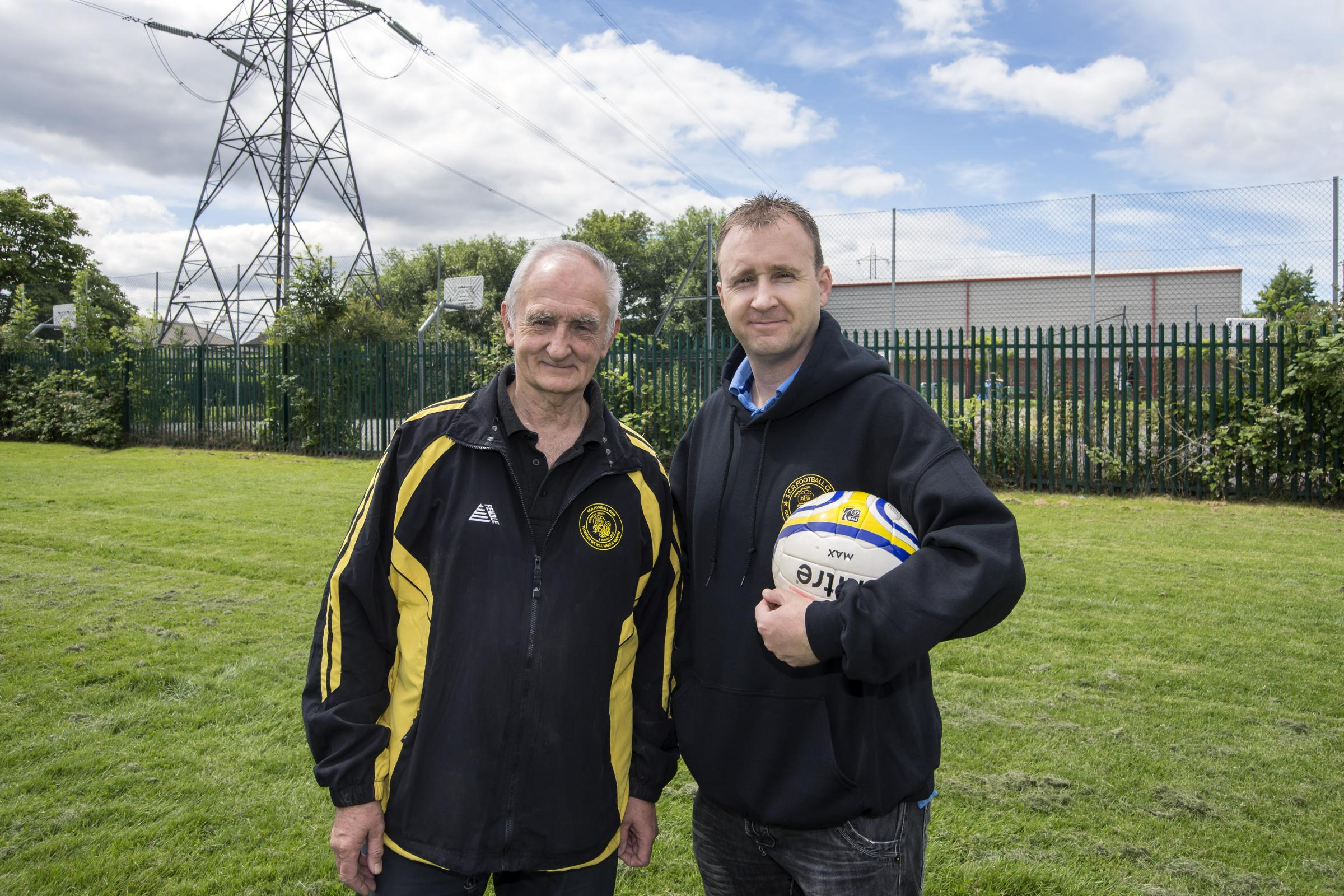 Alan Salmon, chairman of Sutton Common Rovers, and his son Justin, the club's development officer