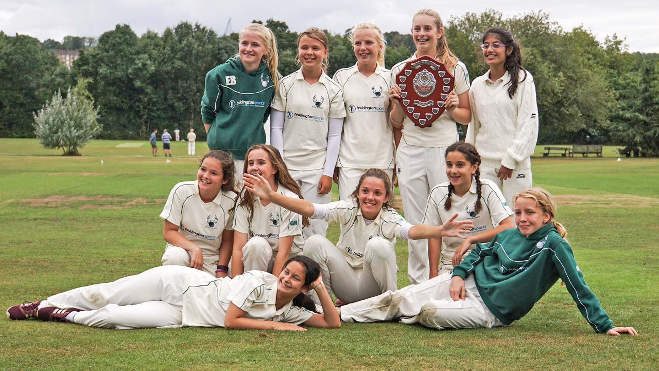 Fruits of their labour: Double county champions celebrate at North London Cricket Club last week