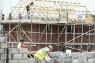 STOCK PHOTO  Builders lay blocks on a building site near Bristol. PRESS ASSOCIATION Photo. Picture date: Wednesday August, 24, 2016. Photo credit should read: Ben Birchall/PA Wire Wire