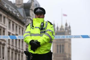 A police officer near Westminster where a terrorist carried out a savage attack on Wednesday, March 22