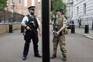 A police officer and a soldier on duty at the back entrance of Downing Street. Photo:PA Wire