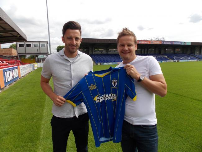 Chris Whelpdale with manager Neal Ardley after signing for the club last season