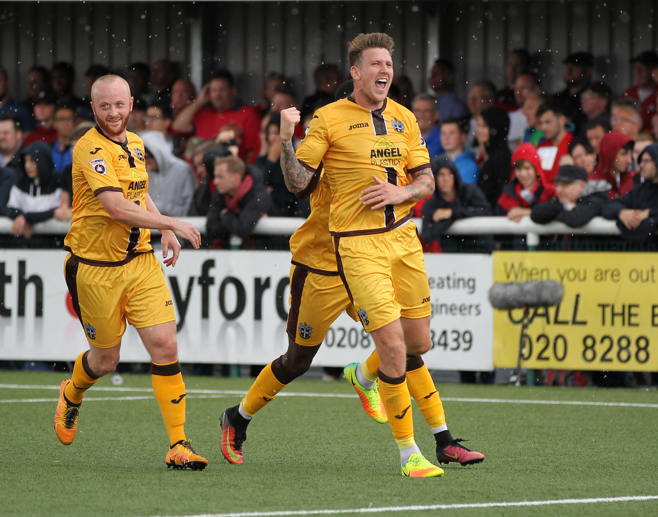 Kenny Davis, Kieron Cadogan (hidden) and Dean Beckwith celebrate Sutton United's second goal in their 2-0 victory over Leyton Orient in August, the last time the U's featured live on BT Sport. Picture: Paul Loughlin