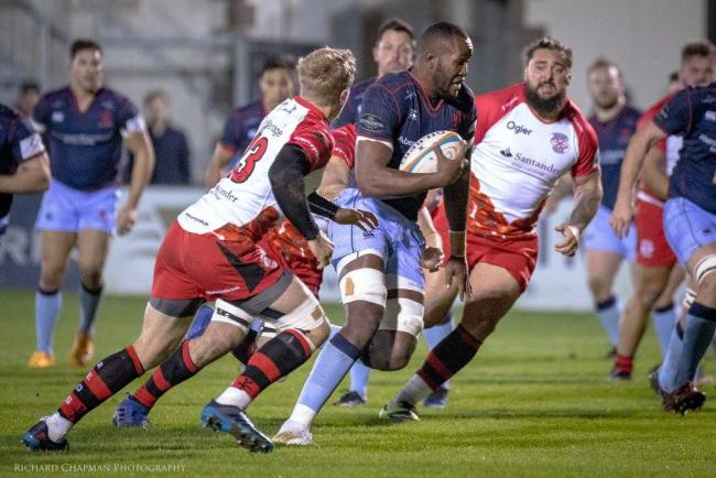 Namibian International Tjiuee Uanivi on the charge for London Scottish at Jersey Reds