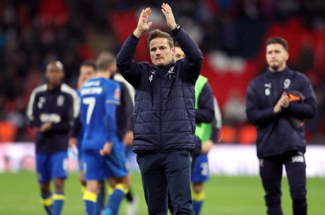 AFC Wimbledon manager Neal Ardley with his team. Photo: Adam Davy/PA Wire