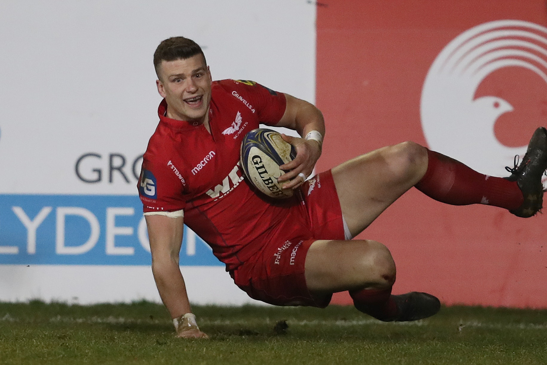 Llanelli Scarlets Scott Williams scores their fourth try during the Champions Cup match at the Recreation Ground, Bath.