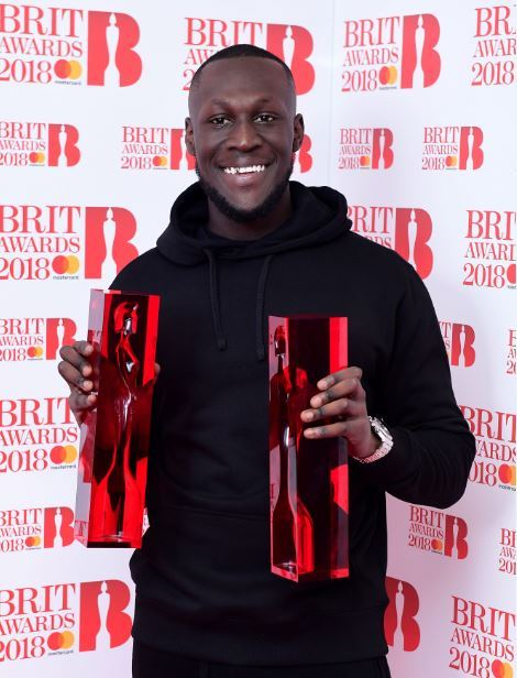 Stormzy with his British Album of the Year and British Male Solo Artist awards in the press room during the Brit Awards at the O2 Arena, London. PRESS ASSOCIATION Photo. Picture date: Wednesday February 21, 2018. See PA story SHOWBIZ Brits. Photo credit s